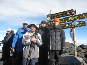 Sensei Mike and his sighted guides on top of Mt. Kilimanjaro